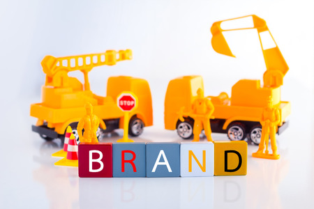 machinery space: Building up brand word inside plastic block with toy figure Brand idea concept.jpg