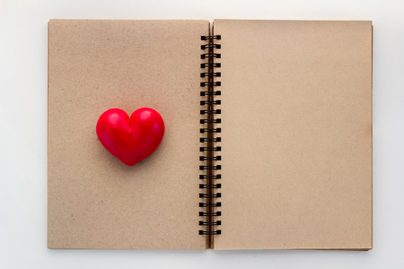open your heart: Blank open notebook with red heart and copy space for your text Stock Photo