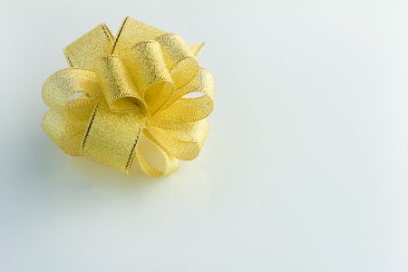 selectively: gold bow on the white background