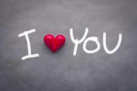 i love you concept with red heart and free hand drawing on grey background