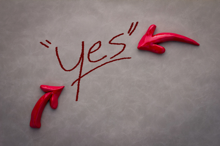 indecision: yes word with red arrow on grey background