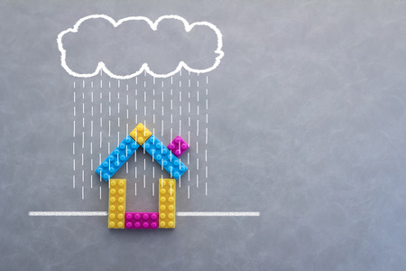 rainy season: model house against the Field Rainy Season drawing on grey background Stock Photo