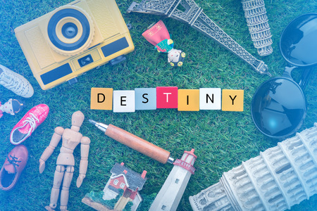 destiny concept with souvenirs around the world on green grass view from top.jpg