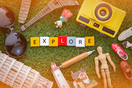explore concept with souvenirs around the world on green grass view from top.jpg