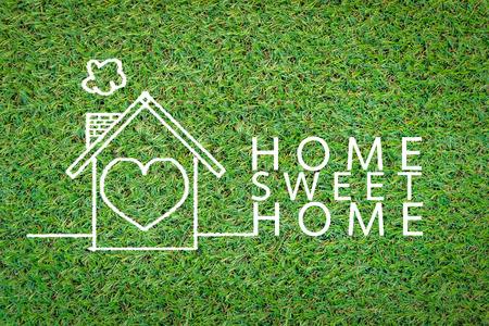 fiesta familiar: hogar dulce hogar en el dibujo background.jpg campo de hierba Foto de archivo