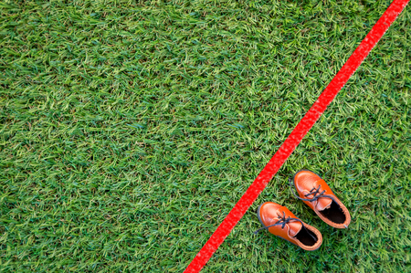 shoe with red line drawing on grass floor challenge concept