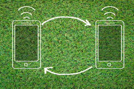smart phone icon on grass field with copy space for your text Stock Photo