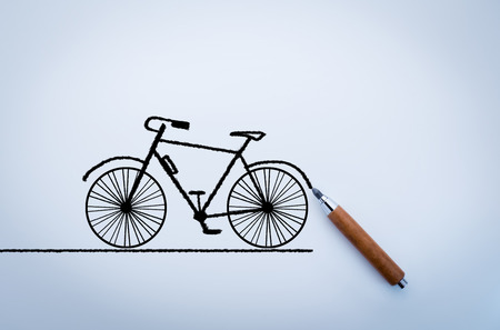 drawing of bicycle with pencil on white background Stock Photo
