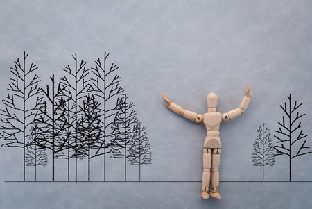 proportions of man: wooden figure on grey background with drawing of tree eco concept