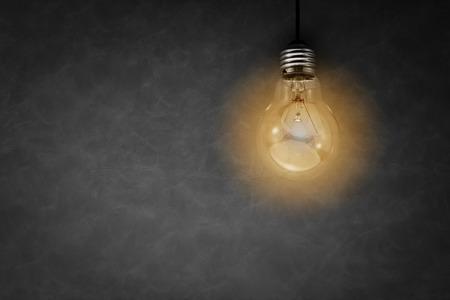 glowing light bulb: glowing light bulb on grey background