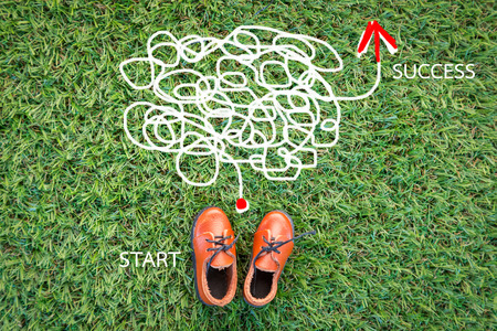decipher: toy leather shoe on grass field texture background with copy-space Stock Photo