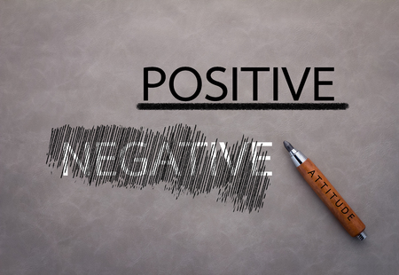 positive and negative concept on grey background attitude concept