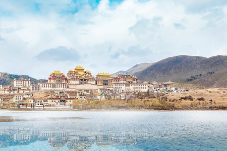 Landscape with tibetan monastery and lake in Zhongdian city china.jpg
