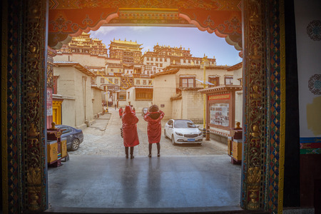 tibetian: april 14 2016 two tourist in Songzanlin Temple in  Yunnan province China Editorial