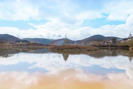 lamaism: Landscape with tibetan pagoda and lake landscapejpg Stock Photo