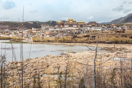 lamaism: Landscape with tibetan monastery and lake  in Zhongdian city china.jpg