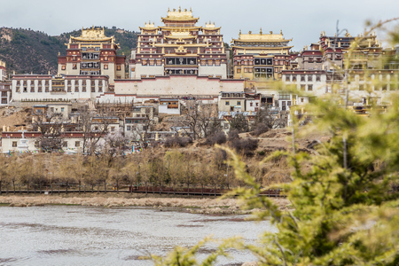 tibetian: Songzanlin Temple also known as the Ganden Sumtseling Monastery, is a Tibetan Buddhist monastery in Zhongdian city( Shangri-La), Yunnan province China and is closely Potala Palace in Lhasa Editorial