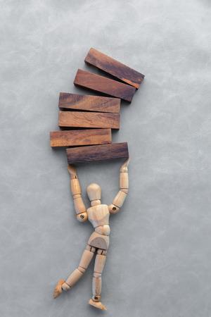 establishes: Creative idea. wooden businessman presenting creative idea using wood block