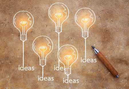 bulbs growing drawing on brown background Creativity ideas concept