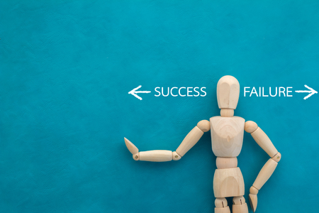 failed strategy: success and failure with wooden figure on color background