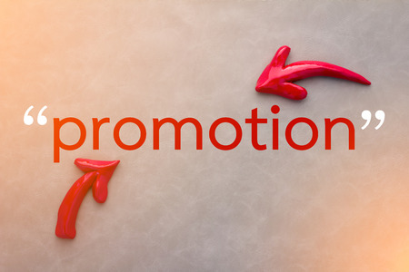 leather background: promotion concept with red arrow on grey leather background