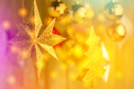 newyear: shiny  tree gifts and decoration in christmas and newyear in golden color