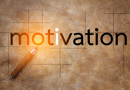 motivator: motivation concept with text on brown texture background Stock Photo