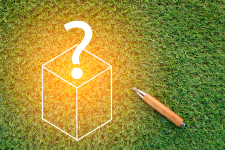 sharp pencil: sharp pencil with box and question mark on green grass  texture background with copy-space