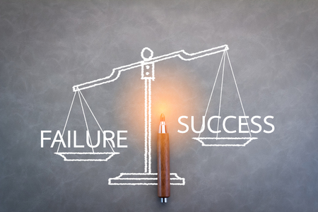 grey scale: failure and success word on scale with grey background Stock Photo