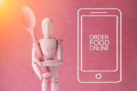 wooden figure: order food online smart phone doodle and wooden figure food business concept Stock Photo