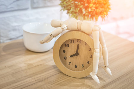 wooden figure: treepot and alarm clock with wooden figure and wooden table