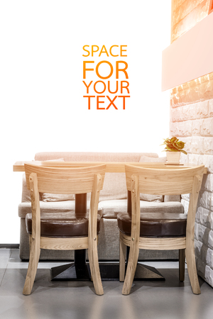 restaurant tables: Wooden chairs in cafeteria interior space.