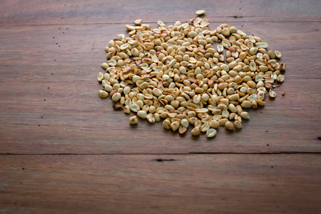 dry peanut crunchy on wooden table ingedient for healthy food