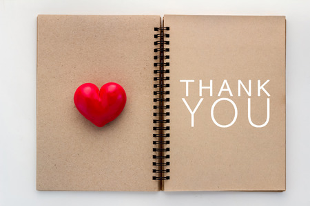 thank you concept with Blank open notebook and red heart and copy space for your text