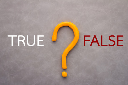 factual: true or false decision concept with text and question on grey leather background