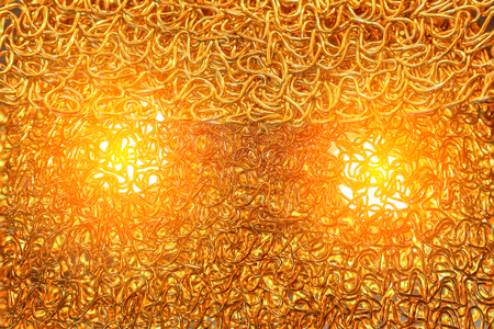 strands: Extremely fine strands of Gold metal wire with len flair inside Stock Photo