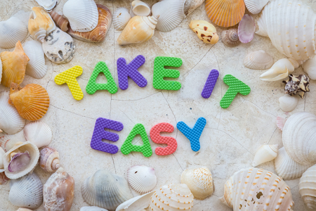 take it easy: take it easy with wrd text and sea shell frame background