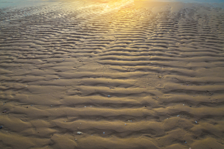sun rise: beach sand texture background at sun rise morning time