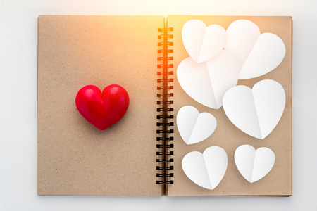 Blank open notebook with red heart and copy space for your text Stock Photo
