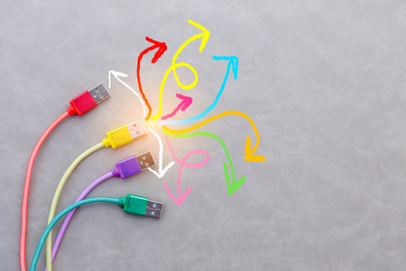 kommunizieren: colorful cable and drawing creative line on grey background. New Bright Ideas