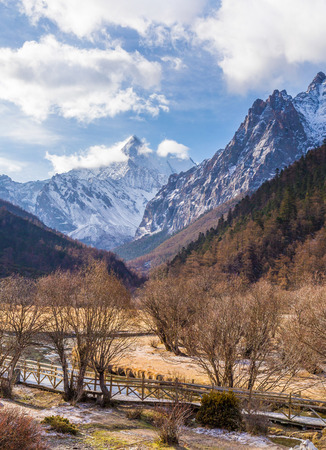 amongst: River on meadow amongst mountain valley. Natural composition Yading China