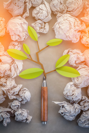 thorn tip: eco concept with tree grew from pencil with trash paper background.jpg