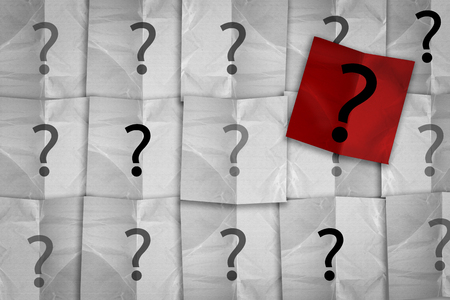 undetermined: white and red paper pad with question mark symbol creativity ideas concept