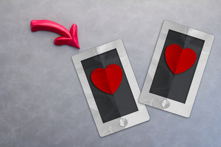 dating: Online dating app concept with smart phone and heart shape paper cut on grey background