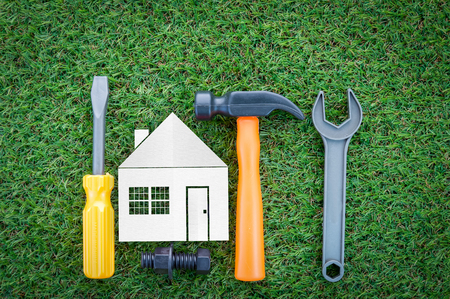 House construction renovation abstract background and tools on grass texture background Archivio Fotografico