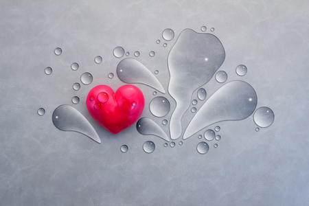 red heart with water drop on grey background Stock Photo