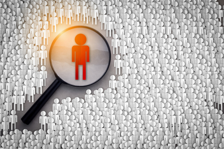 Searching for the right person concept , Magnifying glass focusing on the red man standing with many normal people paper cut shape on grey background
