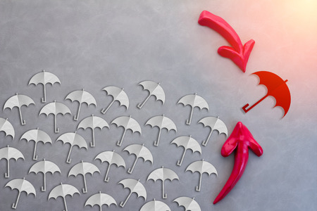 red umbrella: red umbrella flying high from others white  cretivity ideas concept Stock Photo