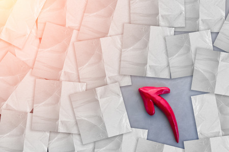 piece of paper: red arrow with white piece paper note on grey background creativity ideas concept