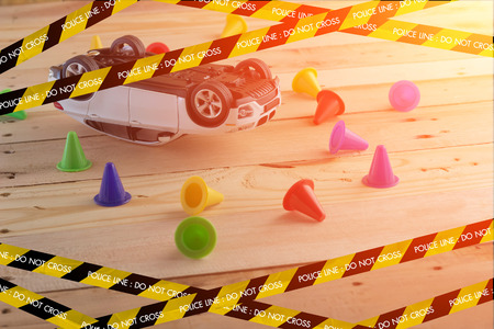 solicitude: car crash and accidents concept on wooden floor